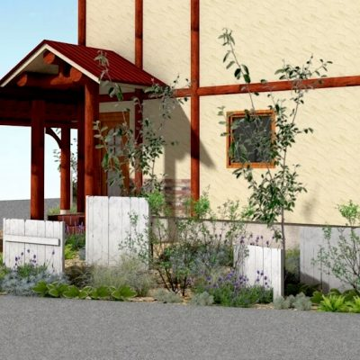 白い木製フェンスとブドウ棚のある庭